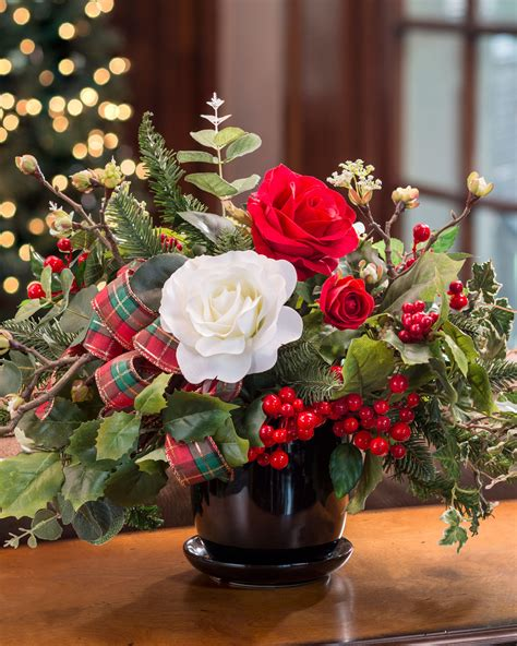 festive roses holly silk flower centerpiece at petals