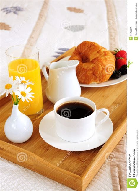 bed breakfast inns breakfast on a bed in a hotel room stock photos image