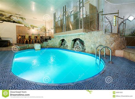 comfortable water temperature for swimming pool blue swimming pool in modern spa interior stock photo