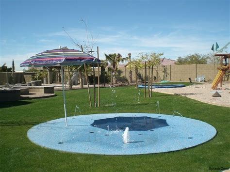 backyard splash pad and in ground troline for the