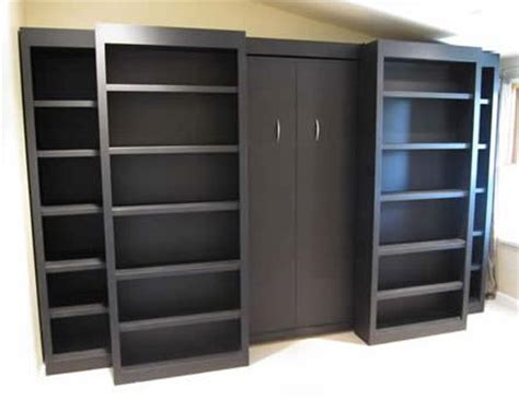 sliding bookcase murphy bed 29 best images about sliding bookcases on pinterest