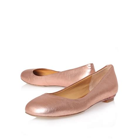 gold flat shoes for nine west guzzler flat shoes in gold gold lyst
