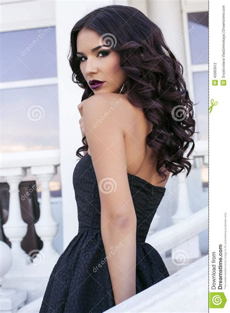 dark haired beautiful women modeling clothes girl with black hair and bright makeup wearing elegant