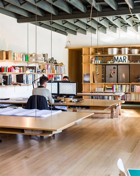 open floor plan office space open office plan with suspended work tables not sure how