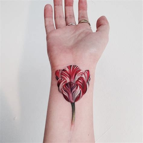 flower wrist tattoo 18 amazing flowers wrist tattoos