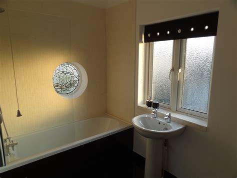 Bathroom Windowsill limestone mosaic tiles on windowsill and enclosing bath shower modern bathroom