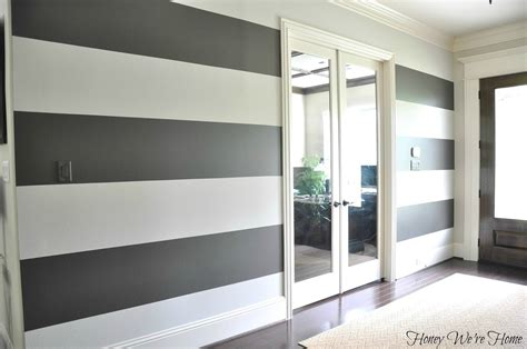 how to paint horizontal stripes on a bedroom wall how to paint perfect wide stripes honey we re home