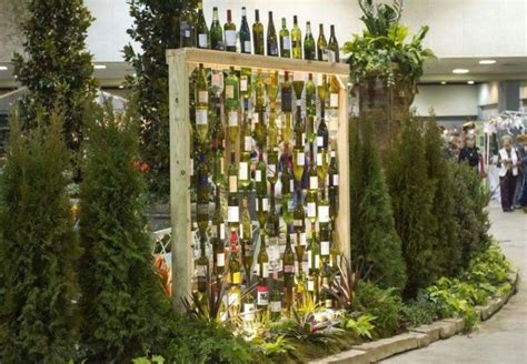 60 Creative Diy Glass Bottle Ideas For Your Outdoor Living Wine Bottle Garden Wall