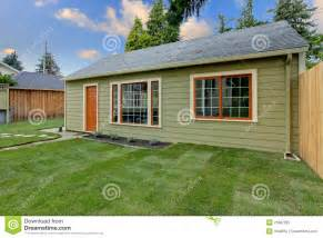 building a guest house in your backyard small green guest house in the fenced backyard royalty