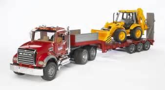 bruder trucks bruder mack granite flatbed truck with jcb loader backhoe