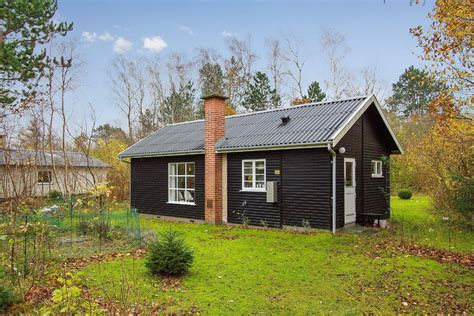 You Ll Fall In Love With This Black And White Cottage White Cottage Coupons