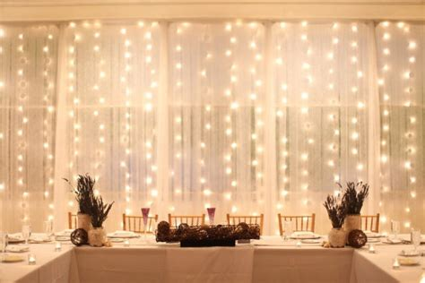 drape lights diy head table backdrop weddingbee