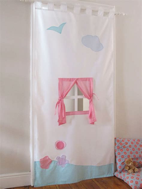 hanging curtains in doorway take a tension rod put on door frame take an old curtain