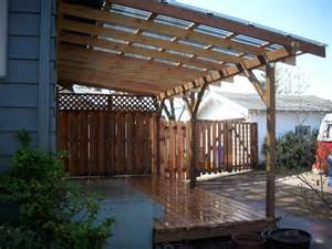 Polycarbonate Patio by Cedar Deck W Polycarbonate Patio Cover And Recycled Gates