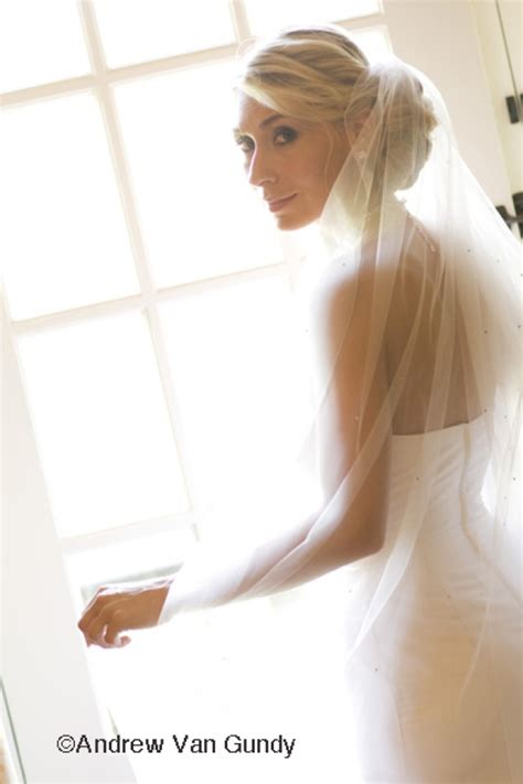 Wedding Hair And Veil Placement by Veil Placement Center Above Low Bun Veil Placement