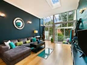 Deep teal wall color modern living room decor ideas brown sofa wood