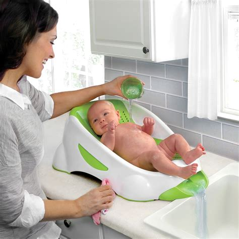 baby in the bathtub munchkin clean baby bath seat baby bath tub