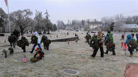despite cold and dozens of volunteers place memorial