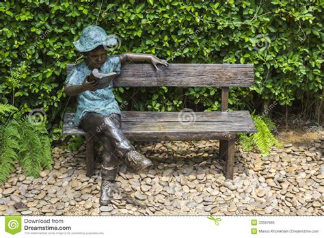 garden sitting bench statue on bench royalty free stock photo image 33567665