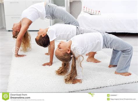 and doing gymnastic exercises at home stock