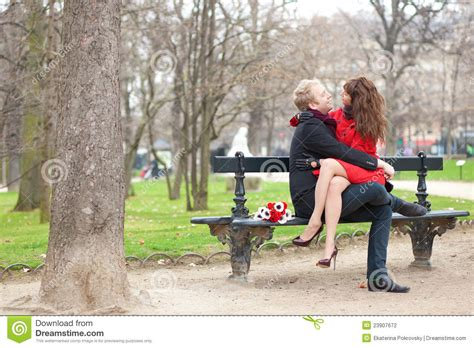 couple on park bench happy romantic couple hugging on a bench stock photography