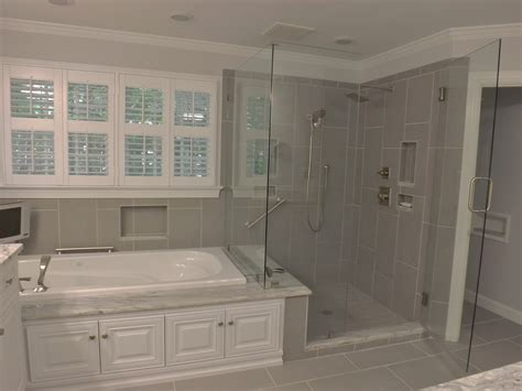 bathroom small renovations ideas with white carved tub panel shiplap grey walls wall