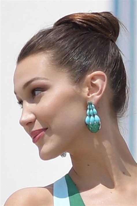 bella hadid straight medium brown bun updo hairstyle