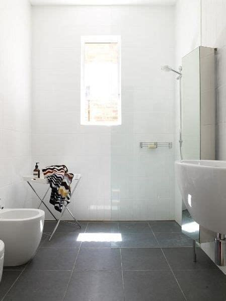 bathroom grey floor tiles colouring clean lines big white wall tiles big grey