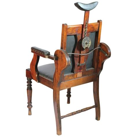 unique antique american leather and wood adjustable chair