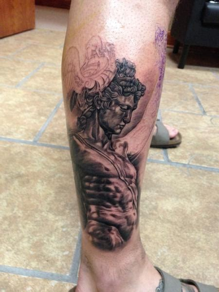 the start of a greek mythology leg sleeve perseus statue
