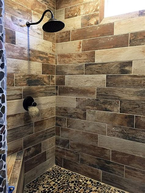 wood tile bathroom wood look tile shower with pebble floor bathroom tiles