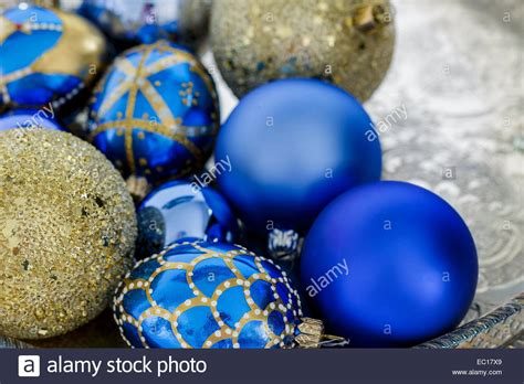 blue and gold christmas decorations on a silver tray stock