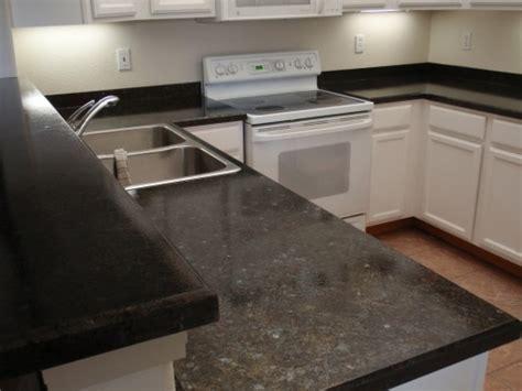 Refinish your laminate countertop to look like granite.