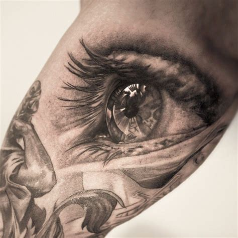 This awesome photo realistic eye tattoo is by Niki Norberg « « Ratta Tattoo