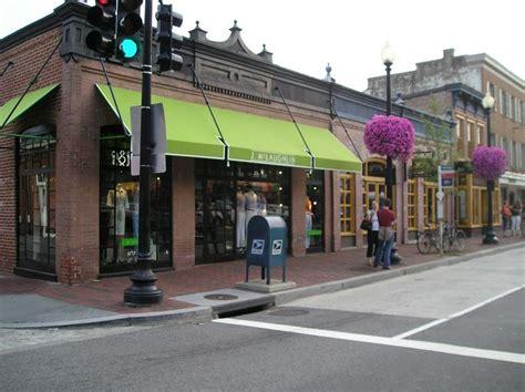 green awnings brick wall green awning restaurant facade pinterest