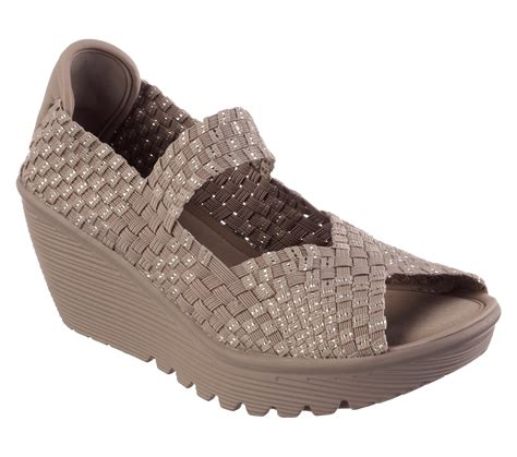 Sendal Skecher Original Wedges Stretch Weave Memory Foam White unmatched comfort and pretty woven style comes in the skechers cali parallel sandal soft woven