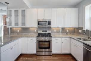 grey tile kitchen backsplash black granite counter top and white