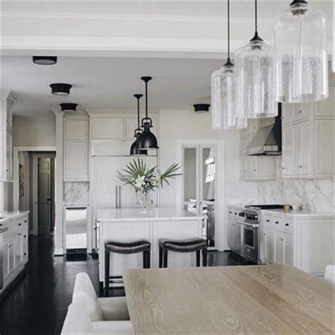 dining room pendant lights a ceiling canopy creates a sleek finish for this dining