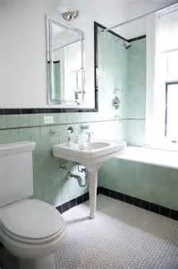 borders bathroom: accentuating black border tiles on the bathroom walls