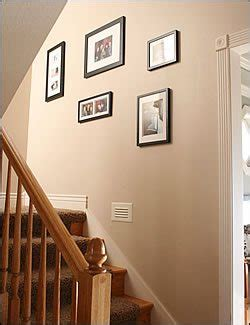 how to arrange pictures on a wall without frames the painless way to arrange a wall collage blissfully