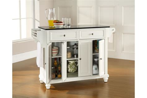 white kitchen island with black granite top cambridge solid black granite top kitchen island in white finish by crosley