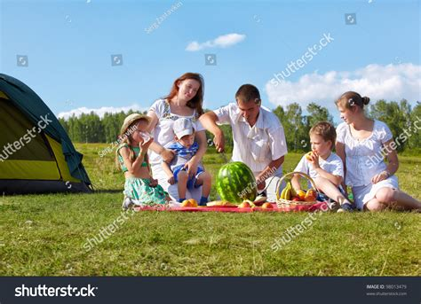 outdoor portrait of happy family picnic on