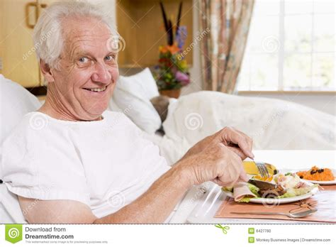 food bed senior man eating hospital food in bed stock photo image 6427780
