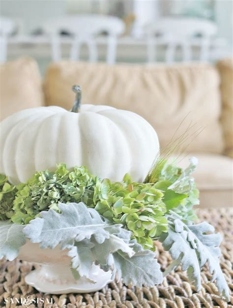 white centerpiece hydrangea and white pumpkin fall centerpiece sand and sisal