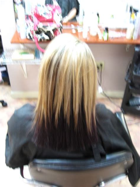 blonde with black underneath hairstyles blonde and dark purple underneath our very own salon