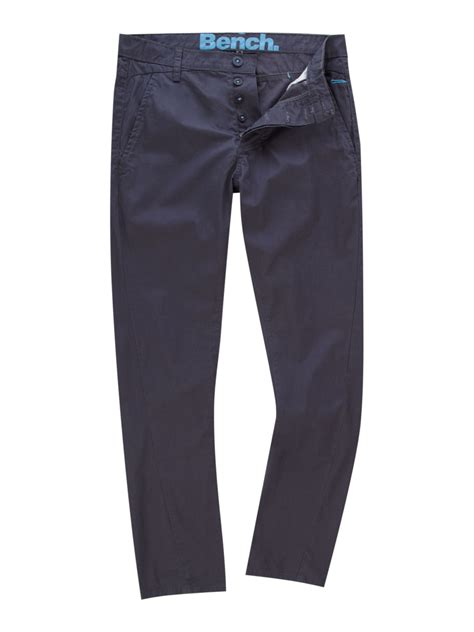 bench twist leg skinny carrot chino trousers in blue for