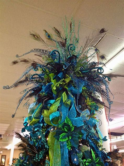 large peacock inspired tree topper with lots of blue and