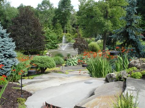 Backyard River Design by Ferdian Beuh Diy Landscaping Designs River Rock