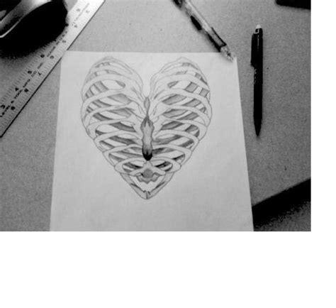 heart tattoos rib cage rib cage heart tattoos piercings pinterest