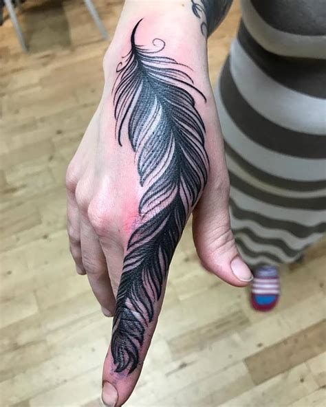 feather tattoo on hand 59 inspiring feather ideas that are distinct and